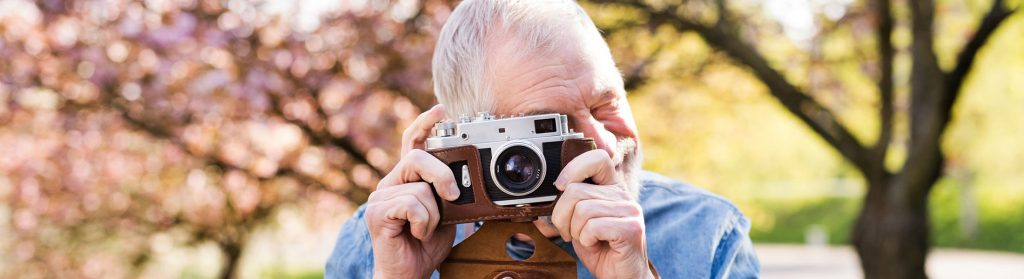 older man with camera